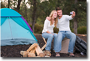 Guy and Girl Enjoying Camping